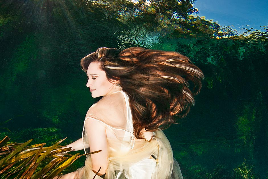 The underwater photographer Silvia Boccato interrogates the fluid universe from the underwater perspective, she creates a fashion and conceptual image in an upside-down world she makes a look at a world from below creating something deeper